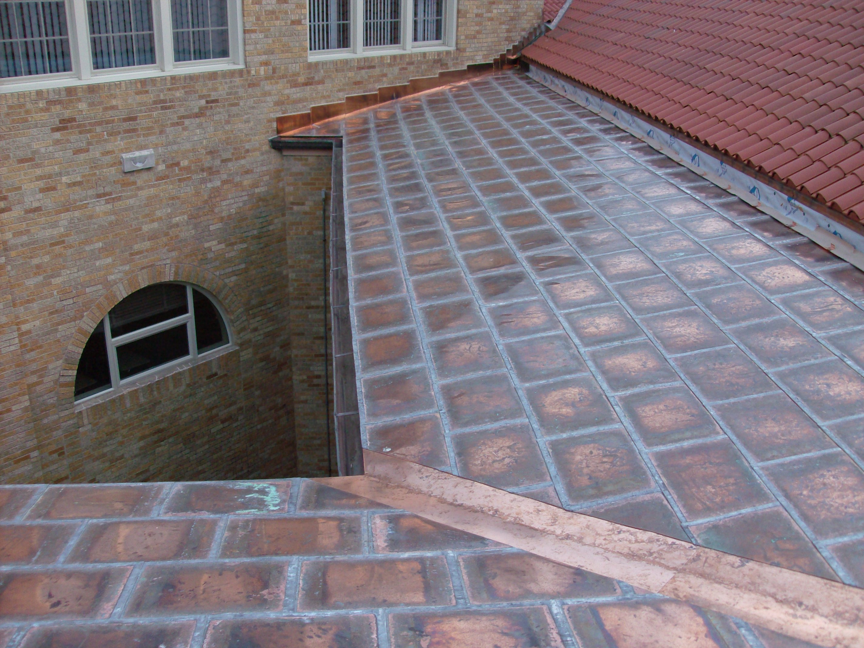 Copper flat lock roof with custom copper counter flashing.
