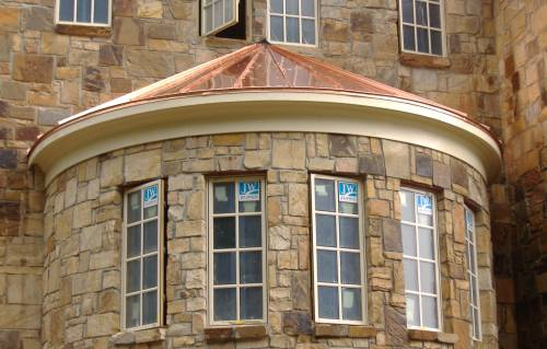 Copper standing seam turret roof front view
