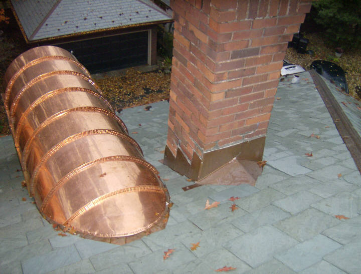 Copper barrel dormer standing seam roof with 180 degree radius.