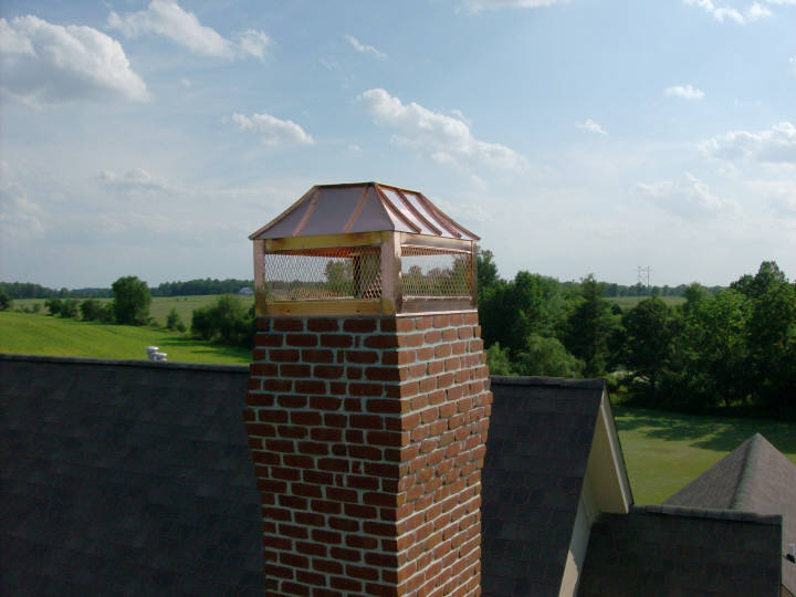 Custom copper chimney cap shroud with flat top.