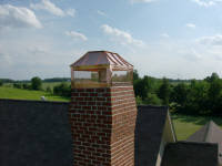 Custom copper chimney cap or shroud.