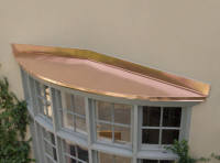 Custom copper bow or bay window hood roof.