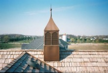 Custom copper cupola with copper louvers and gem-style finial.