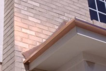 Custom copper gutter, curved counter flashing.