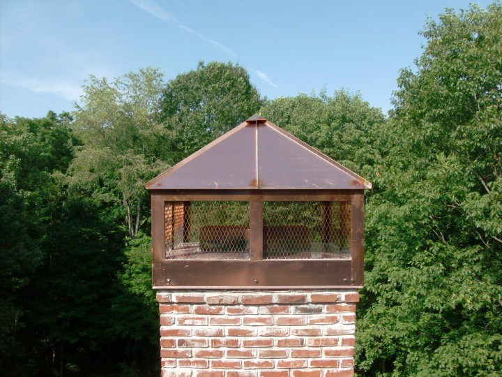 Custom copper chimney cap (or shroud) with hinged access, installed.