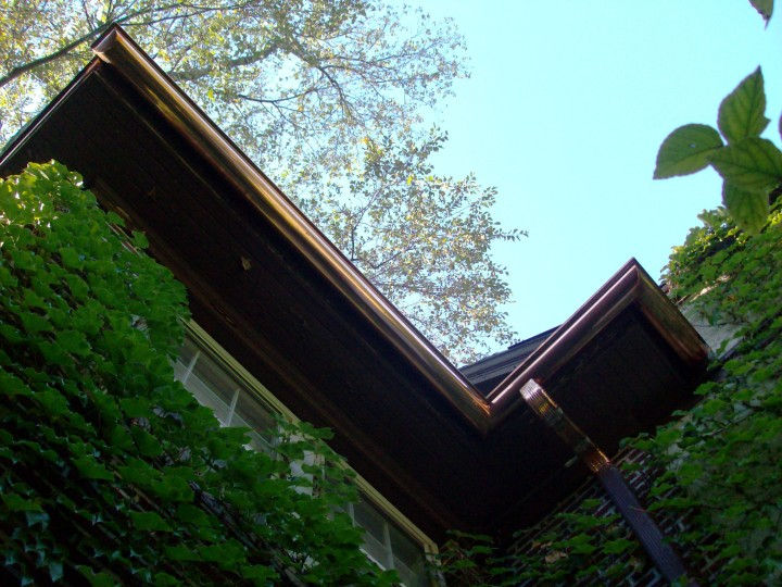 Custom copper half-round gutters.
