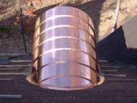 Copper barrel dormer standing seam roof.